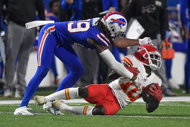 Kansas City Chiefs wide receiver Tyreek Hill, right, is tackled by Buffalo Bills cornerback Josh Norman during a game Oct. 19 in Orchard Park, N.Y.