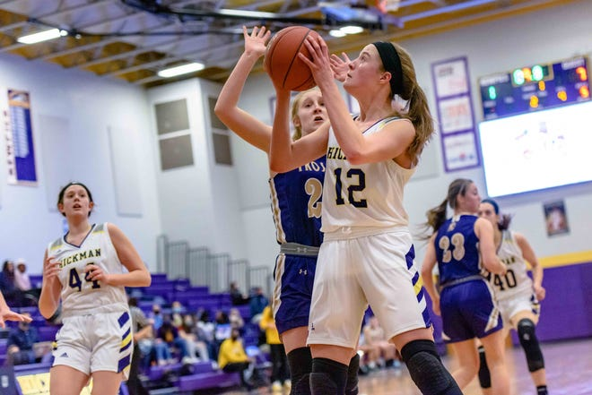 Hickman's Ella Rogers (12) makes a move toward the basket during a game against Troy Buchanan on Tuesday night at Hickman High School.