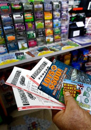 Ohio's 2020 lottery sales topped 2019 sales despite pandemic restrictions on stores. Dennis Balaz of Sunbury bought a variety of lottery tickets at Hub Carry Out, 245 N Columbus St, Sunbury, on Wednesday, January 20, 2020.