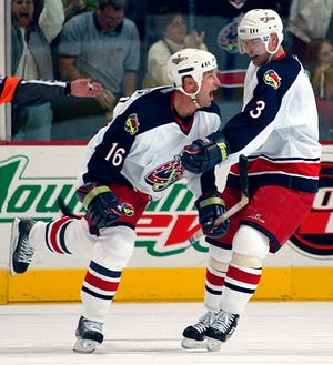 Mike Sillinger (16) of the Blue Jackets celebrates his second-period goal with teammate Jaroslav Spacek in the 2002 home opener, a 2-1 win over Chicago.