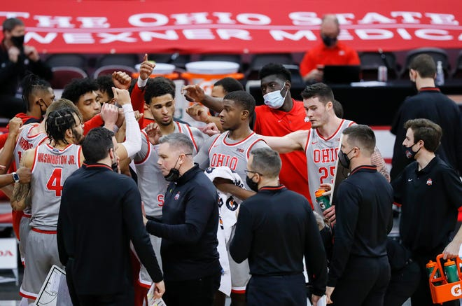 The Ohio State Buckeyes huddle during a timeout in the second half of the men's basketball game against the Purdue Boilermakers at Value City Arena in Columbus on Tuesday, Jan. 19, 2021. Purdue won 67-65.