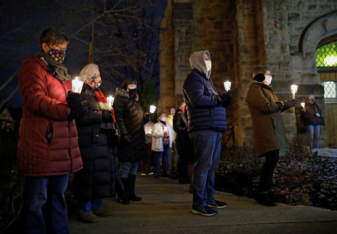 Members of King Avenue United Methodist Church in the University District pray during a candlelight service on Jan. 19, 2020, in Columbus, Ohio. The service on the eve of Inauguration Day was held to pray for the peaceful transition of power and the healing of a divided nation.