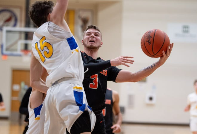 Massillon's Luke Sabo fights through contact against Wooster's Drew Dossi. Sabo scored 20 points in Massillon's win.