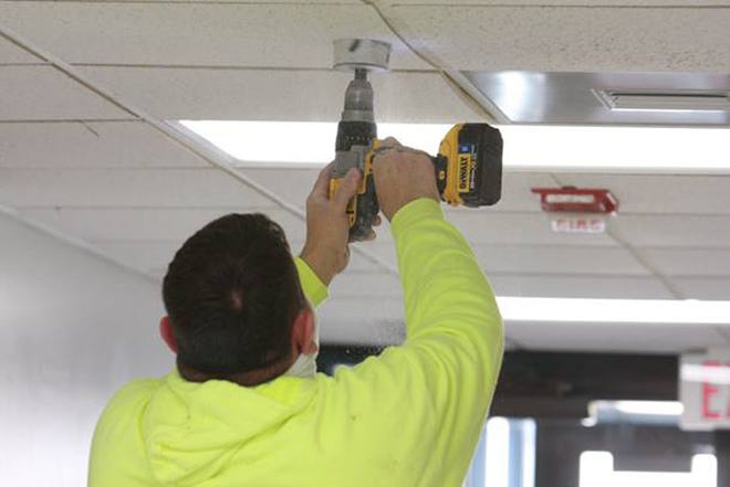 DCCC security staff install new camera systems that are set to be completed throughout campus by Jan. 22.