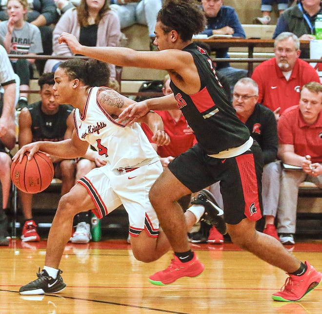 Central Davidson's Jaydon Rusnak (right), shown here pressuring North Davidson's Ja'Mir McNeair during their first-round state playoff game on Feb. 25, 2020, scored 19 points in the Spartans' 55-52 win over Thomasville on Tuesday. [Michael Coppley for The Dispatch]