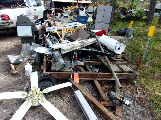 This is scrap metal that Stephen Horton is accused of dumping along the right-of-way at 8899 State Road 11 in western Flagler County. The state had placed yellow markers to indicate the right-of-way, according to the Flagler County Sheriff's  Office.