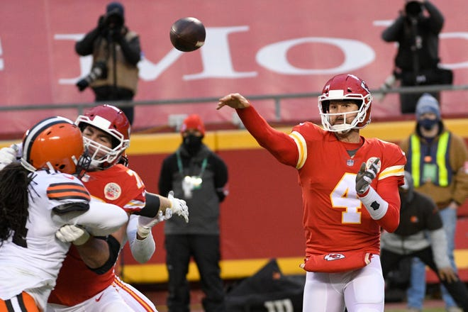 Kansas City Chiefs quarterback Chad Henne throws a pass during the second half of Sunday's AFC divisional playoff against the Cleveland Browns. Henne said he returned from an injury last season for moments like these, when he helped the Chiefs hang on for a 22-17 win.
