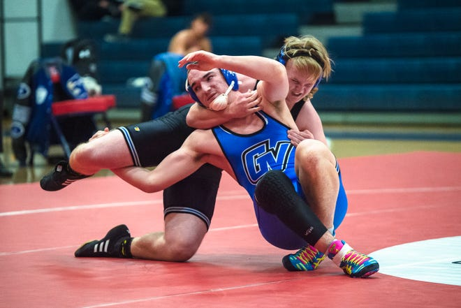 Grain Valley's Shane Duckworth, front, and Blue Springs South's Gavin Mahurin in their 182-pound match Tuesday at Truman High School. Duckworth eked out an 8-7 decision to help the Eagles top the Jaguars 43-33.