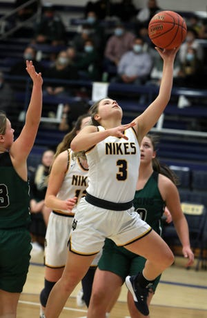 Notre Dame High School's Karli Artman (3) goes up for a basket during their game against West Burlington High School, Tuesday Jan. 19, 2021 at Notre Dame's Father Minett Gymnasium.