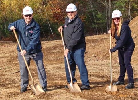 Palmer Gas & Oil President and owner, Bill Ermer breaks ground on a Somersworth facility along with his son Charlie Ermer and daughter Joanne Ermer, both vice presidents in the family-owned business.