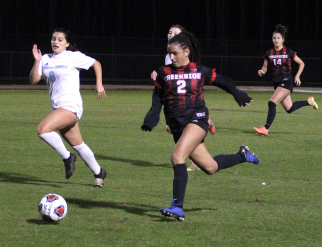 Creekside fullback Gianni Badon (2) dribbles upfield on her way to scoring the game-winning goal as Ponte Vedra's Victoria Villasana defends during a high school girls' soccer game last week.