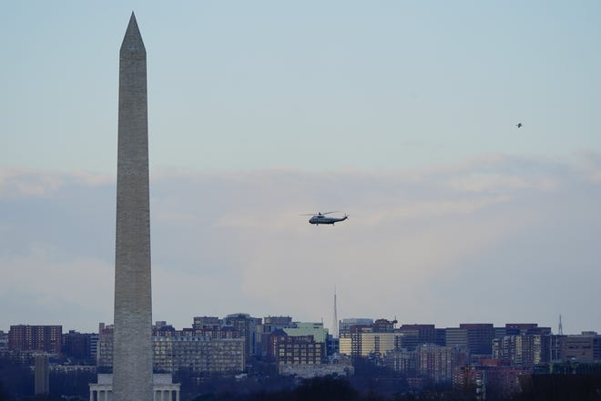 Marine One helicopter, with President Donald Trump and first lady Melania Trump aboard, flies over the National Mall in Washington, Wednesday, Jan. 20, 2021. (AP Photo/Patrick Semansky, Pool)