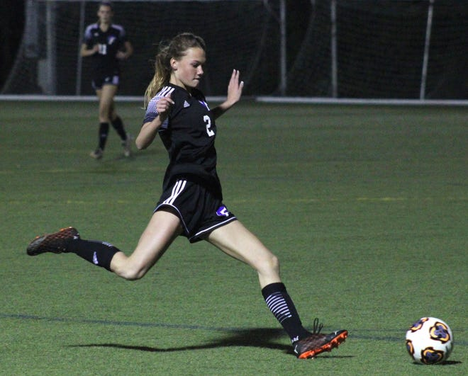 Fletcher defender Avery Langlois (2) prepares to strike a cross during a Gateway Conference girls soccer semifinal against Mandarin. The freshman scored a goal in the title game to help secure the team's first championship in seven years.