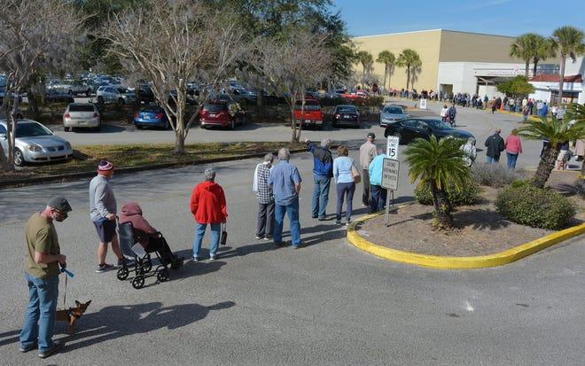 Residents wait in line in January to get to the entrance of the former Sears store at Regency Square mall for their chance to receive a COVID-19 vaccination at the state of testing site. Saturday the site officially closed as the country has steadily improved getting control of the virus.