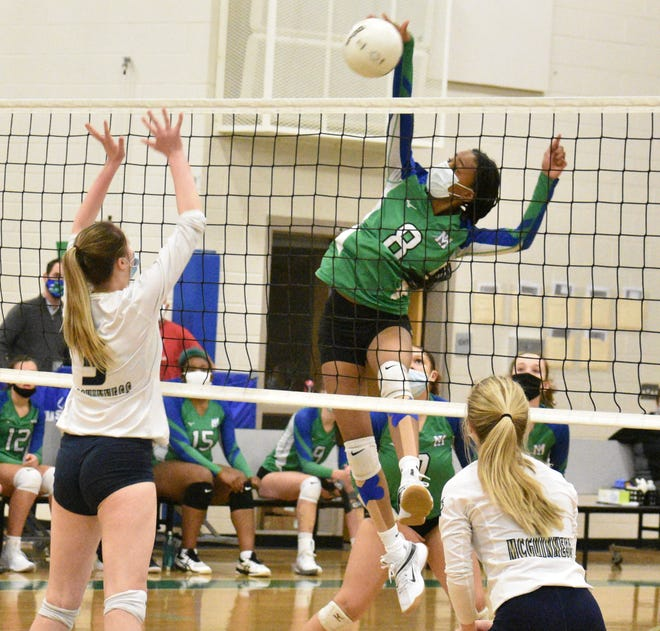 Mountain Island Charter's Giselle Little rises for a kill during Tuesday's West 1A volleyball final against Bishop McGuinness. [JOE L. HUGHES II/Gaston Gazette]