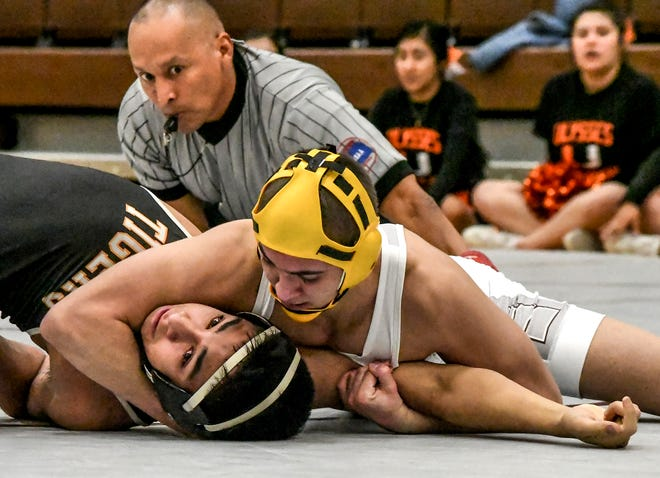 Garden City High School's Steven Sellers, right, works on pinning Ulysses' Drake Anguiano in a match last season at GCHS.