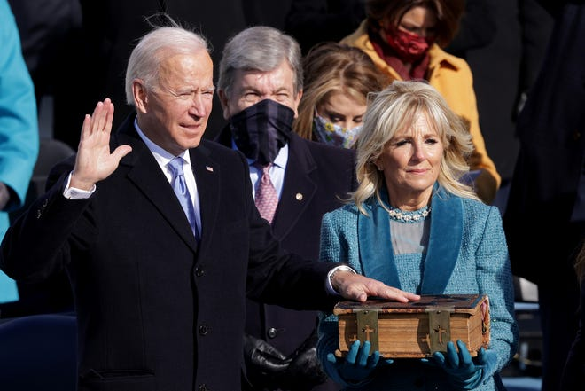Joe Biden is sworn in as U.S. President during his inauguration on the West Front of the U.S. Capitol on Jan. 20, 2021, in Washington, DC.  During today's inauguration ceremony Joe Biden becomes the 46th president of the United States.
