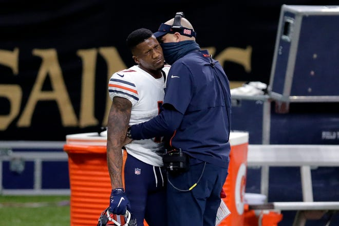 Chicago Bears wide receiver Anthony Miller reacts as head coach Matt Nagy talks to him, after he was ejected for unsportsmanlike conduct in the second half of an NFL wild-card playoff football game against the New Orleans Saints in New Orleans on Sunday, Jan. 10.