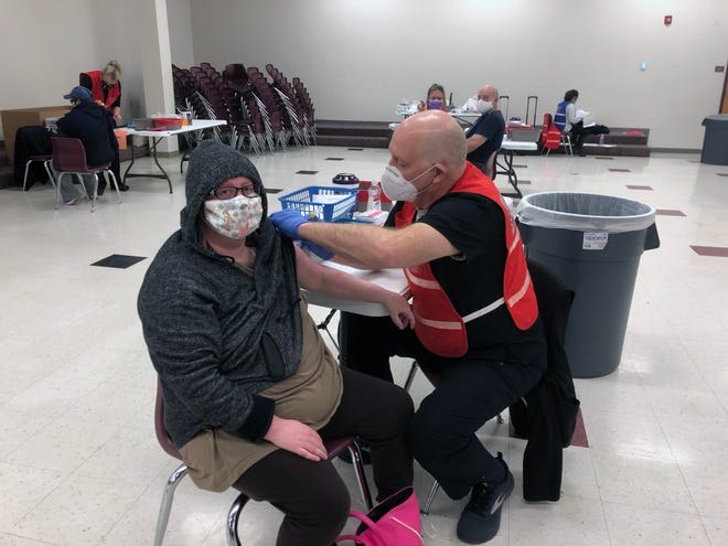 Grayson County Health Authority Dr. Jerry Bennett vaccinates Ashlea Allen at a shot clinic at Sherman High School in this file photo from a couple of weeks ago. Those clinics continued this week with people being vaccinated off the county's waiting list.