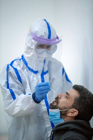 A health professional administers a Covid-19 test to a resident of Ponta Garça, São Miguel, Azores, on Jan. 19, 2021.