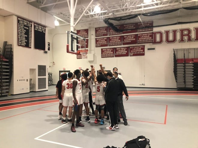 The Durfee boys basketball celebrate on Tuesday after beating league opponent Brockton at home