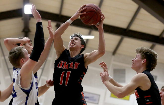 Inman's Tanner Heckel (11) shoots past Caiden Duerksen (35) during their game at the Burrton Invitational Tournament Tuesday night. Inman defeated Goessel 60-41. Heckel was the team's high scorer with 17 points in the game.
