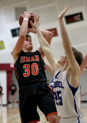 Inman's Dawson Mannebach (3) shoots past Goessel's Skyler Wuest (25) during their game at the Burrton Invitational Tournament Tuesday night. Inman defeated Goessel 60-41.