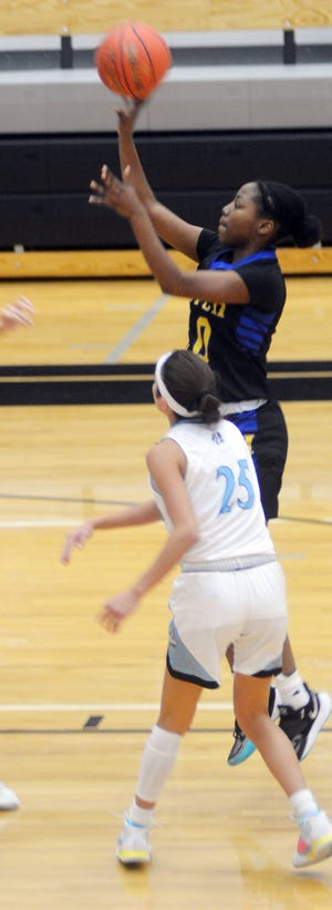 Hutchinson senior Ziya Simms takes a jumper Tuesday at Goddard Eisenhower. Simms led Hutchinson with 11 points in a loss to Eisenhower.  [MARK SCHNABEL/NEWTON KANSAN]