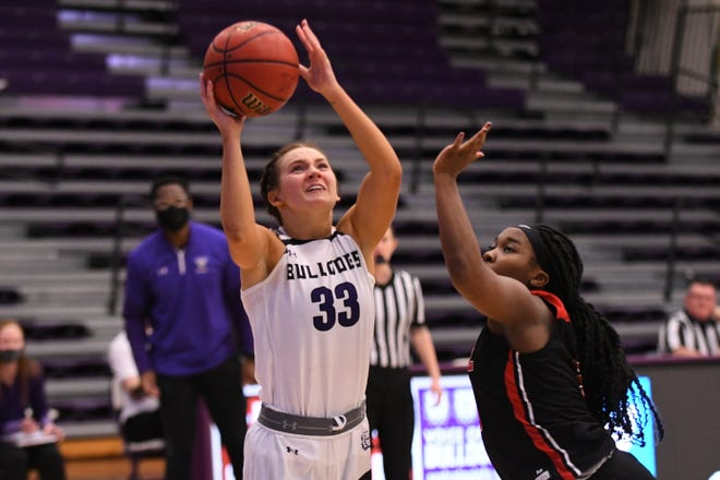 Truman junior guard Katey Klucking goes for a layup during the third quarter of Tuesday's game against Missouri-St. Louis.