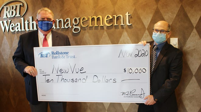 Martin J. Connors, president, Rollstone Bank & Trust, and Marc Dohan, executive director, NewVue Communities.