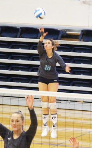 Otero Junior College's Antia Vallecas (18) serves the ball against Garden City (Kan.) in a match played last season. The Lady Rattlers open the season on Friday.