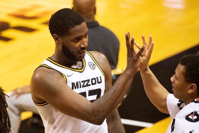 Missouri's Jeremiah Tilmon, left, celebrates with Javon Pickett after he came off the court during the second half of the team's NCAA college basketball game against South Carolina on Tuesday, Jan. 19, 2021, in Columbia, Mo. Missouri won 81-70.