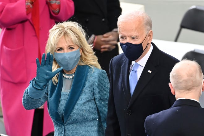 President-elect Joe Biden and his wife Jill Biden arrive for the 59th Presidential Inauguration at the U.S. Capitol for Biden in Washington, Wednesday, Jan. 20, 2021. (Saul Loeb/Pool Photo via AP)