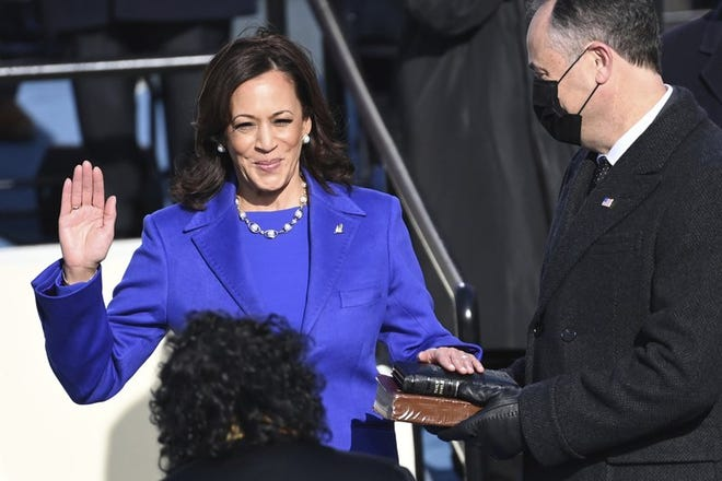 Kamala Harris is sworn in as vice president by Supreme Court Justice Sonia Sotomayor as her husband Doug Emhoff holds the Bible during the 59th Presidential Inauguration at the U.S. Capitol in Washington, Wednesday, Jan. 20, 2021.