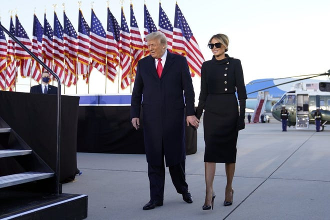 President Donald Trump and first lady Melania Trump arrive to speak before they board Air Force One at Andrews Air Force Base, Md., Wednesday, Jan. 20, 2021.