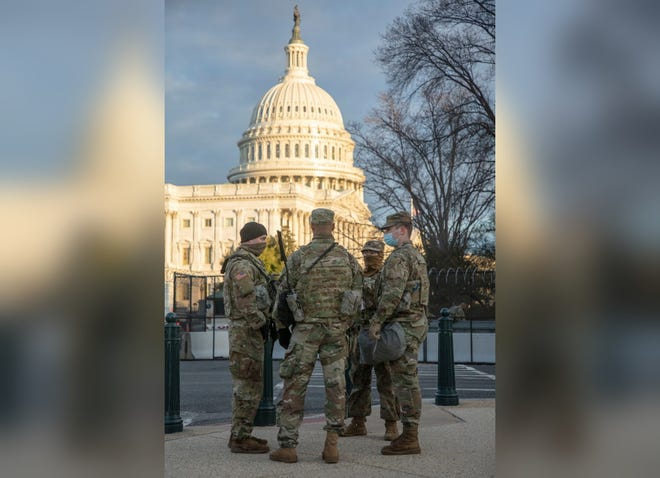 Soldiers from the Massachusetts Army National Guard stood near the U.S. Capitol on Tuesday while providing security support ahead of President-elect Biden's Inauguration.