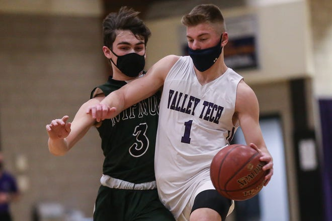 Blackstone Valley Tech senior captain Shea Finnegan drives to the basket with Nipmuc senior Lucas Beder (left) pressuring during a boys basketball game earlier this month. Finnegan recently committed to play basketball in college.