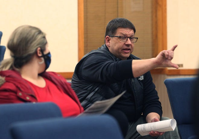 Jeff Lawrence of L & J Development Inc. gestures as he explains to the Moberly City Council at its Tuesday business meeting  how certain construction issues will develop when his firm begins renovating the Council Chamber floor area.