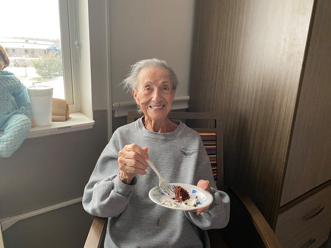 Ontario Center resident Lillian Lake is all smiles with her cake from Wegmans.