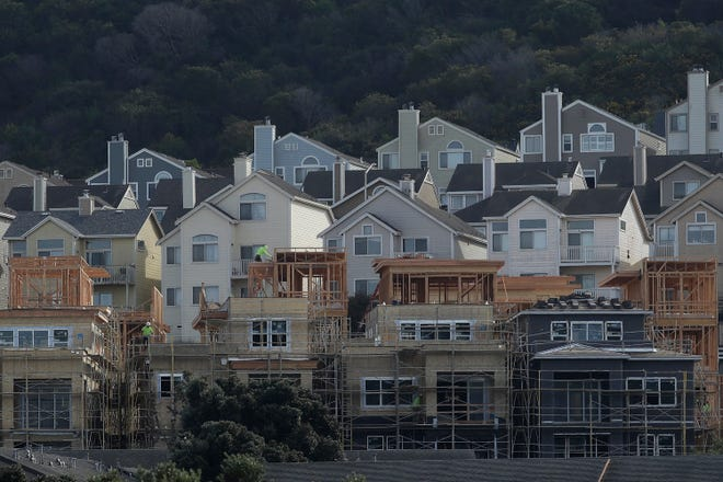 A construction crew works on new homes in San Francisco. [AP File Photo/Jeff Chiu]