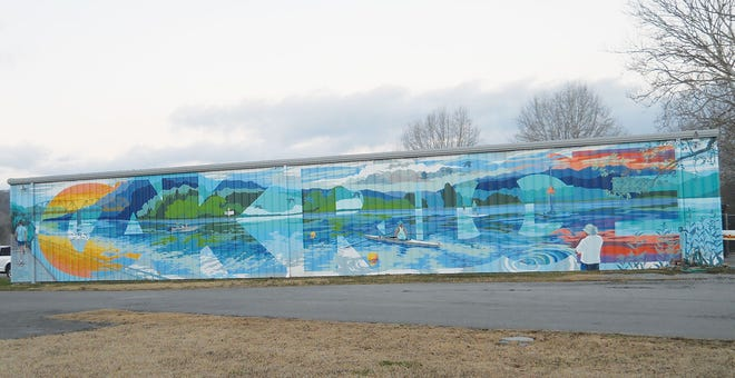 If you've visited Melton Lake Park in the last few months, you've likely noticed a new piece of artwork developing on the side of the Rowing Association's boathouse. The mural, which was painted by local artist Megan Lingerfelt, was completed in December and a ribbon-cutting was held. She worked with Explore Oak Ridge, which is in charge of the city's tourism efforts, and several other members of the Oak Ridge community to come up with the design and bring it to life.