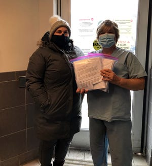 Hamilton resident Collette Pretre, left, poses with Community Memorial Hospital senior director of clinical services Diane Chase recently as Pretre delivered gift meals to hospital workers helping keep the community safe from the coronavirus.
