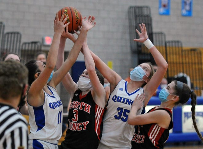 Battling for a rebound are, from left, Quincy's Autumn O'Campos, North Quincy's Orlagh Gormley, Quincy's Caroline Tracey, and North Quincy's Kiera Sleiman during girls basketball action at Quincy High School, Tuesday, Jan. 19, 2021.