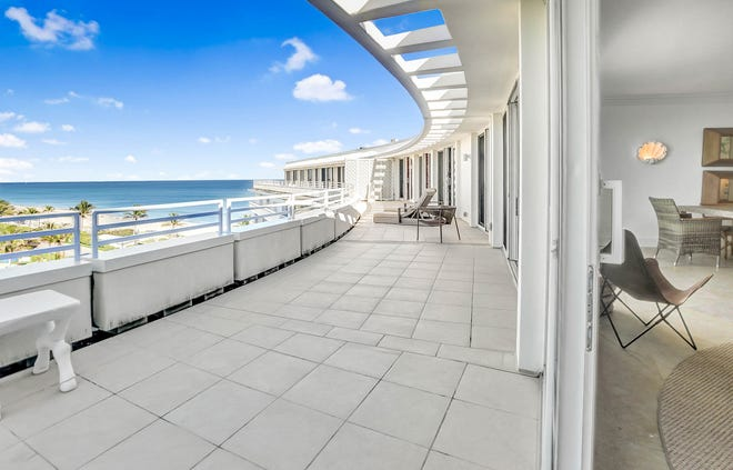 The broad balcony of Penthouse 10 at the Sun & Surf in Palm Beach offers sea views to the northeast. With two bedrooms and a den, the unit is priced at $5.995 million.