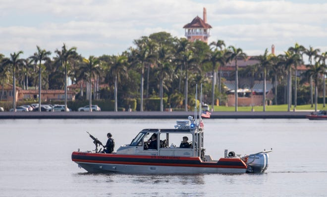 A Coast Guard boat patrols the Intracoastal Waterway behind Mar-a-Lago in Palm Beach before the arrival of ex-president Donald Trump Wednesday, January 20, 2021.