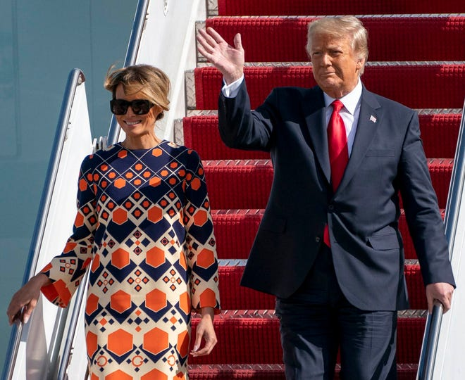 President Donald Trump and first lady Melania Trump arrive at Palm Beach International Airport on Wednesday, shortly before President-elect Joe Biden was sworn in.