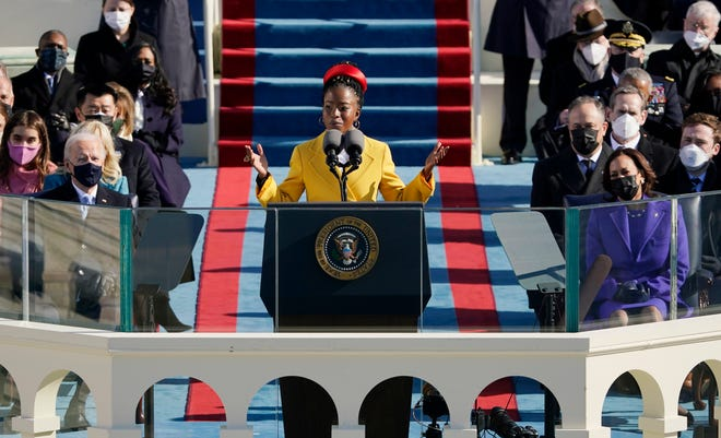 """National youth poet laureate Amanda Gorman recites her inaugural poem, """"The Hill We Climb,"""" during the 59th Presidential Inauguration in Washington."""