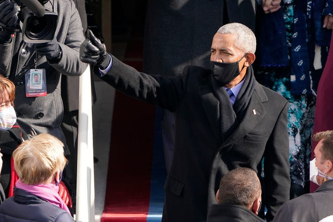 Former President Barack Obama gives a thumbs up after the 59th Presidential Inauguration at the U.S. Capitol in Washington, Wednesday, Jan. 20, 2021.