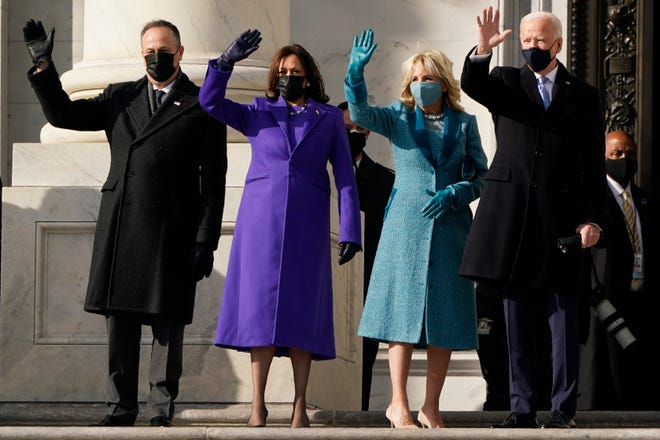 President-elect Joe Biden, his wife Jill Biden and Vice President-elect Kamala Harris and her husband Doug Emhoff arrive at the steps of the U.S. Capitol for the start of the official inauguration ceremonies, in Washington, Wednesday, Jan. 20, 2021. (AP Photo/J. Scott Applewhite) ORG XMIT: DCMS123