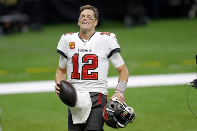 Tampa Bay Buccaneers quarterback Tom Brady smiles after an NFL divisional round playoff football game against the New Orleans Saints, Sunday, Jan. 17, 2021, in New Orleans. The Tampa Bay Buccaneers won 30-20.